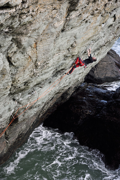 James McHaffie on the upper half of the first ascent of The Gravity Wave (E8 6c), Trearddur Bay. © Ray Wood