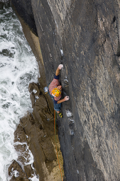 Charlie Woodburn setting out on the first ascent of Something's Burning (E9 7a), Pembroke. © Emma Alsford
