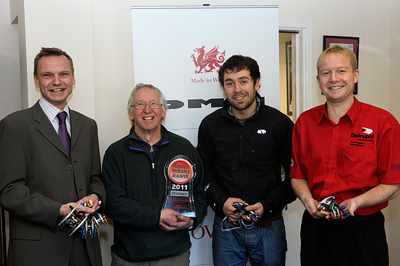 (from left): Matthew Norman (Distrupol), Fred Hall (DMM Technical Director), Elliot Tanner (DMM Design Manager), John Nugent (Distrupol) with the award at DMM in Llanberis.