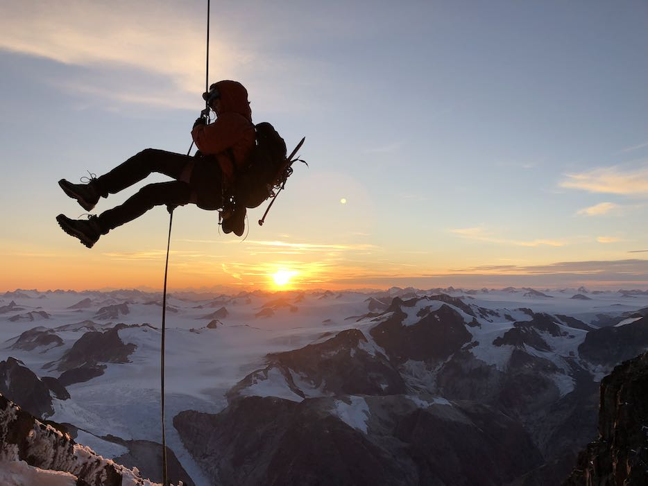 Brette rappelling off of Devil's Paw, Alaska after making the first ascent of  Shaa Téix'i.