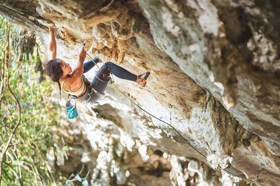 Genevive demonstrating her steep-roof stamina on an unnamed 5.11d (7a) in a newly developed area outside of Vinales, Cuba. © D Scott Clark
