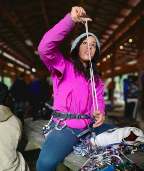 Genevive teaching some basic gear principles on the Intro to Trad course at the 2019 Color the Crag Festival. © L. Renee Blount