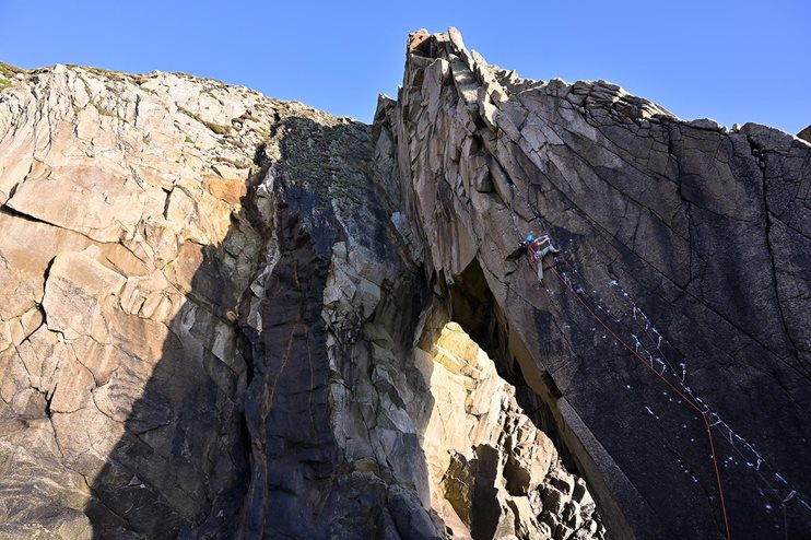 James McHaffie finding his Spirit Guide (E7 6c) on the first ascent, Flying Buttress Area, Lundy Island. © Ray Wood