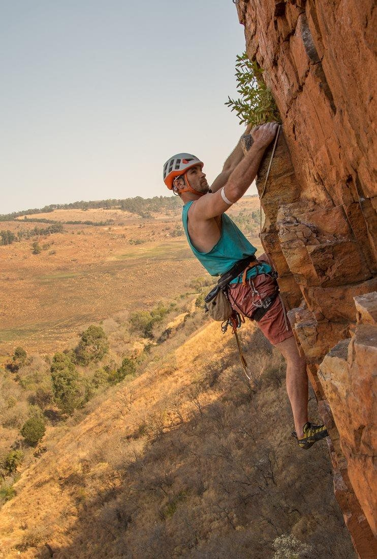 Jesse climbing Bonar (5.10c) at Waterval Boven, South-Africa © Molly-Thompson