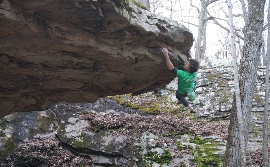 Ricky on the First Ascent of Salo's Extension, V10, Chattanooga Tennesse.