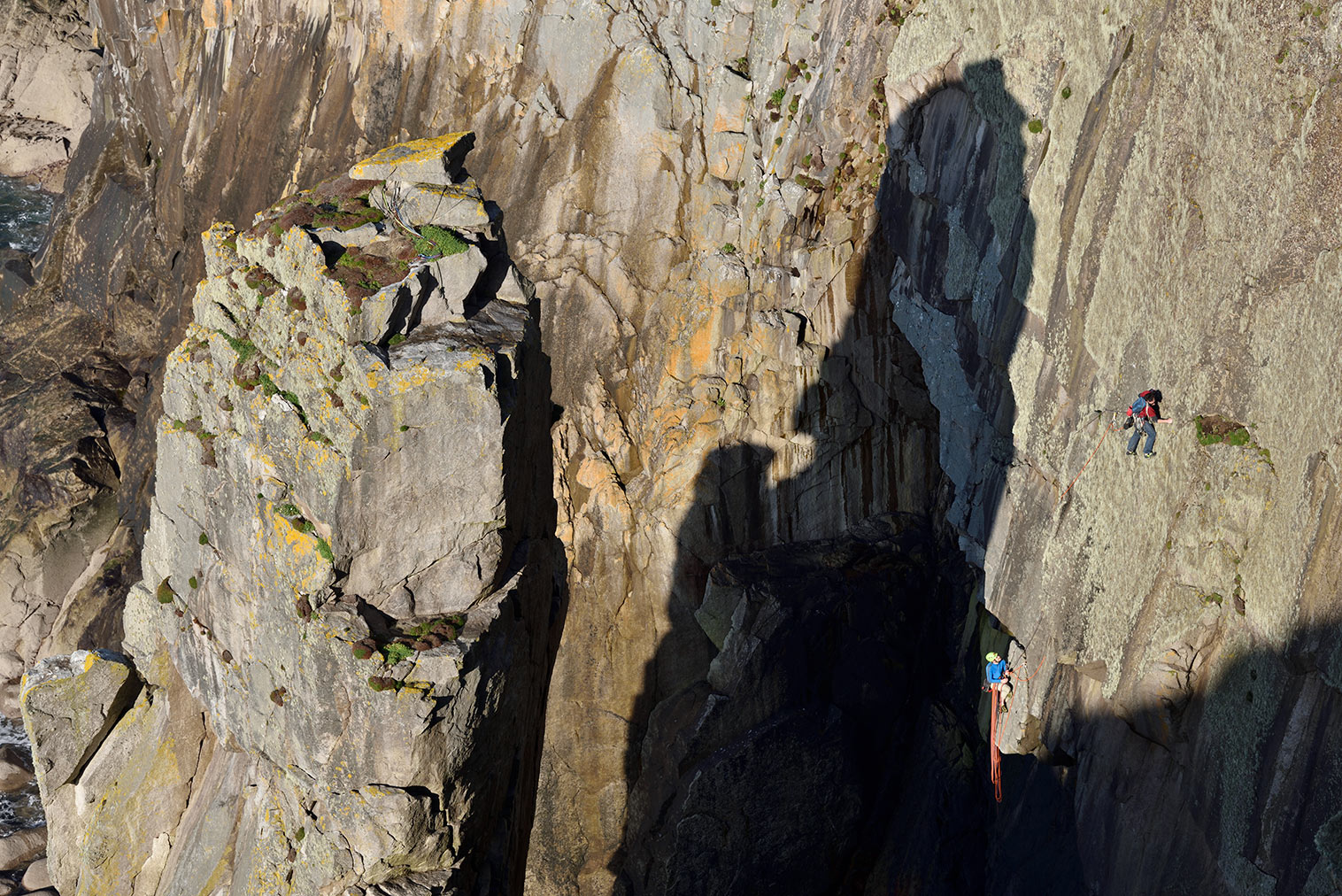 McHaffie and Bede West escaping from the shadow of the Devil's Chimney on Lundy's Promised Land (E3 6a). © Ray Wood