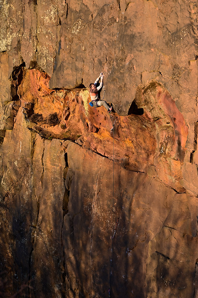 Bransby leading the headwall above the cave and which could be climbed as a pitch in its own right. © Ray Wood