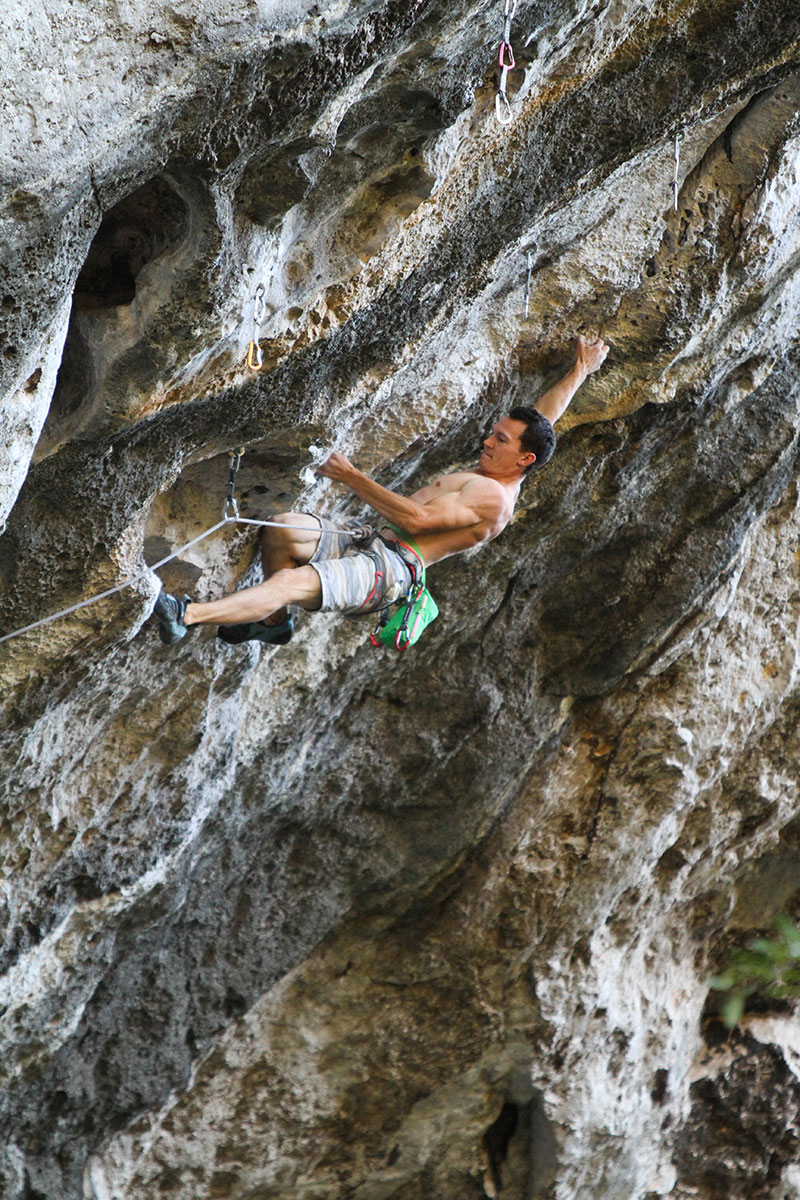 Angus Kille fighting to Keep on Smiling (8a), Thakhek, Laos. © scott@thetravelingclimber