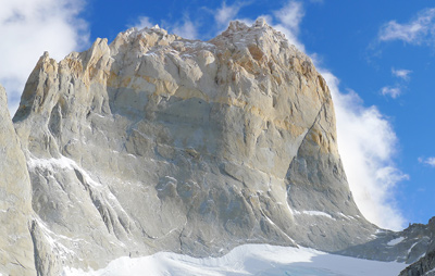 Wall of Paine climbs just left of the right-hand edge of the face above the snow patches on the slabs. © Calum Muskett